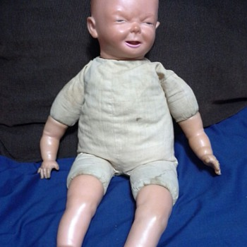 A doll among a collection I inherited.  - Dolls