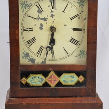 Antique Wooden Mantel Clock with Geometric Designs Maker Unknown