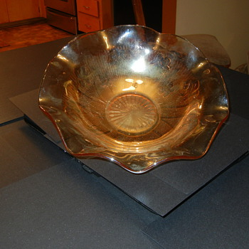 Carnival glass? or just a pretty Peach color scalloped bowl?