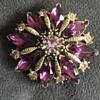 Amethyst colored rhinestone brooch