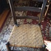 old wood chair with woven cane seat