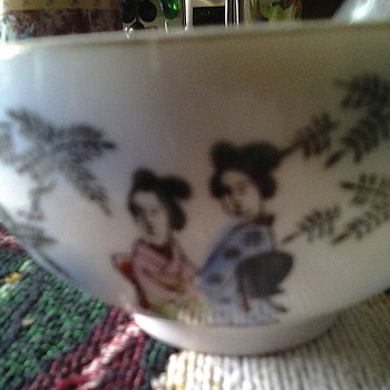 asian cups with lady's face in bottom - Asian