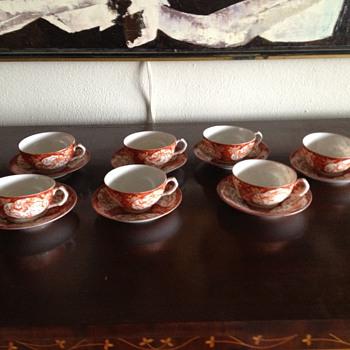 Antique handpainted Imari teacups and saucers