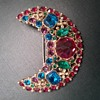 Sphinx jeweled crescent brooch
