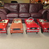 Four Mustang pedal cars