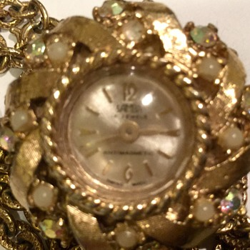 Antique necklace with a decorative clock