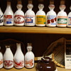 Couple shelves of miscellaneous milk bottles