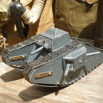 Incredible late 1910s WWI Mk IV female tank. Pressed steel, heavy clockwork, and early cast aluminum.