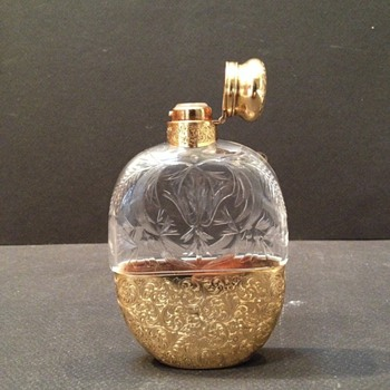 A beautiful ladies flask with gold