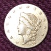 Gold piece with 1854 & Liberty Head