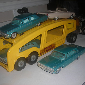 Structo autocarrier with 1963 Ford Galaxie promo cars heading to re-stoc k a dealership like the real thing!