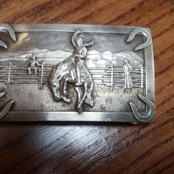 Need some help identifying this buckle please