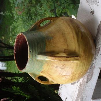 "Primitive Pottery ""Bullet"" Vase?"