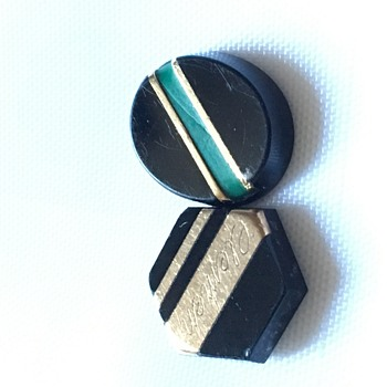 Two small inlaid stones