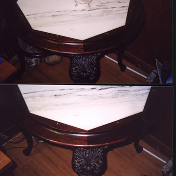 Round marble inlay table with gargoyle legs