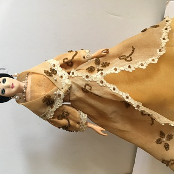 Vintage Doll with pearls on hair and collar and dress,
