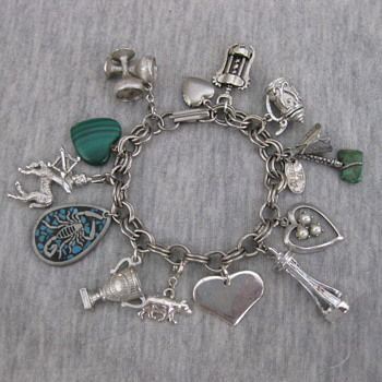 Funky charm bracelet from this and that over the years. - Costume Jewelry