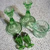 Depression glass candle holders and salt-pepper shakers