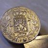 Flip-top coin stamp lighter?