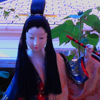 Long haired flute player with Olive Oyl hairstyle    - Dolls