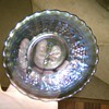 What is this plate? is it Carnival Glass? Did this go to a set?