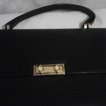 Black hand Bag with a brief case appearance.
