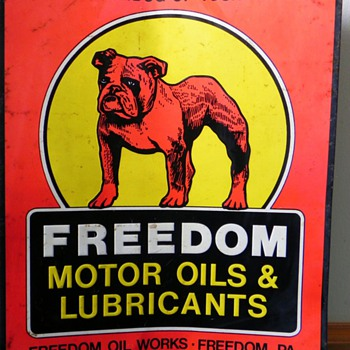Information on a Freedom Motor Oil & Lubricants sign - Signs