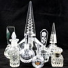 A collection of clear glass perfume bottles