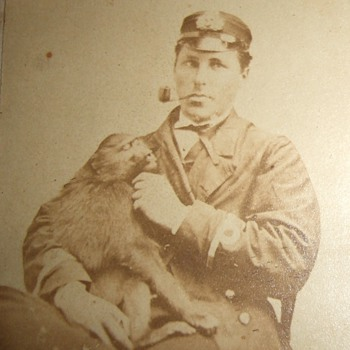 Early image of man with a pet Monkey - Photographs