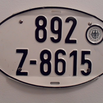 Oval German auto licence plate. - Signs