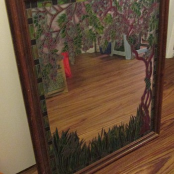 "Mirror with ""stained glass"" trim, and those incredible Tiffany lamps"