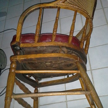 Cane back oak chair vinyl seat four stationary legs springs on chair base allowing top only to rock  - Furniture
