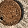 A few Indian Head Pennies, the 1909 has a indent that could possibly be a bullet?