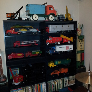 Post 100.  A Group Display Of Previous Posted Pressed Steel Toys