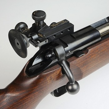 "Redfield ""International Match"" sight mounted on a bolt action ""US Property"" marked Winchester 52--22L Rifle - Military and Wartime"