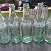 five 6-1/2oz. Coca-Cola bottles