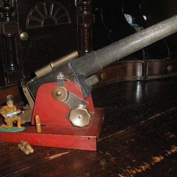 Baldwin Manufacturing Co. Cannon. 1930s wood and pressed steel. - Toys