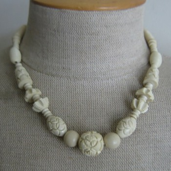 bone colored carved celluloid necklace - Costume Jewelry