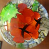 red flower with black birds paperweight