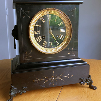 A Mystery Mantle Clock from my family.....