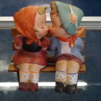 Couple Sitting On Bench Kissing Salt & Pepper Shaker Made in 1959. Manufacturer is National Potteries.