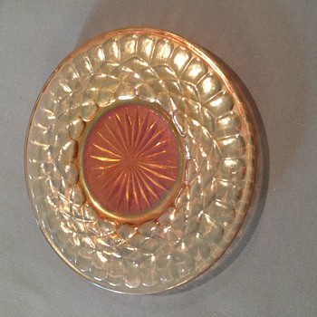 Beautiful Carnival glass plate measures 6 1/2 inches across