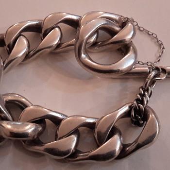 A vintage sterling silver bracelet & another
