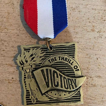 The Thrill of Victory Medal - Medals Pins and Badges