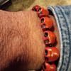 red skulls (plastic beaded bracelet)