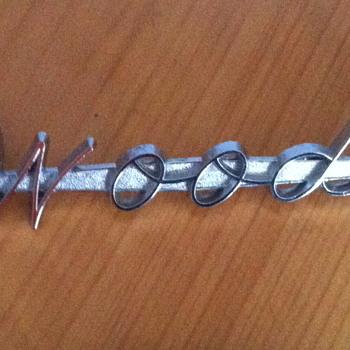 Wood's metal emblem logo. - Advertising