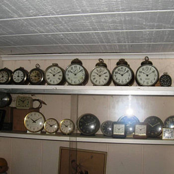 "Here are a few ""tin can"" and alarm clocks - Clocks"