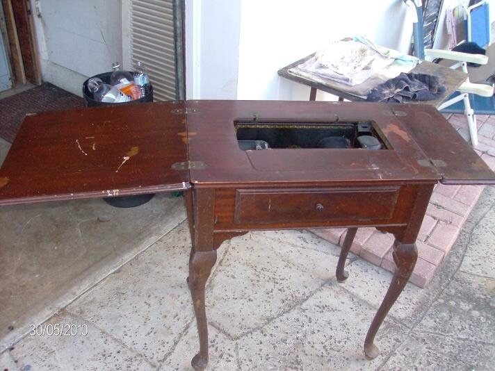 Restored singer sewing machine cabinet | Collectors Weekly
