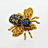 A 14k Gold Brooch Formed As A Bee & Set With Blue Sapphire Stones