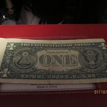 misaligned miscut dollar bill